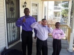 Three boys pose for photo in formal outfits