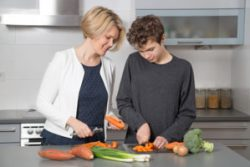 Mother and son cooking