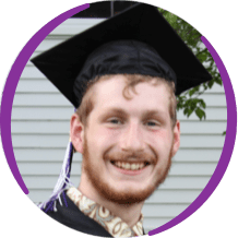 Young man wearing graduation cap smiling