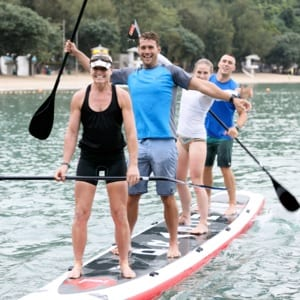 Paddlers smile while riding dragon board